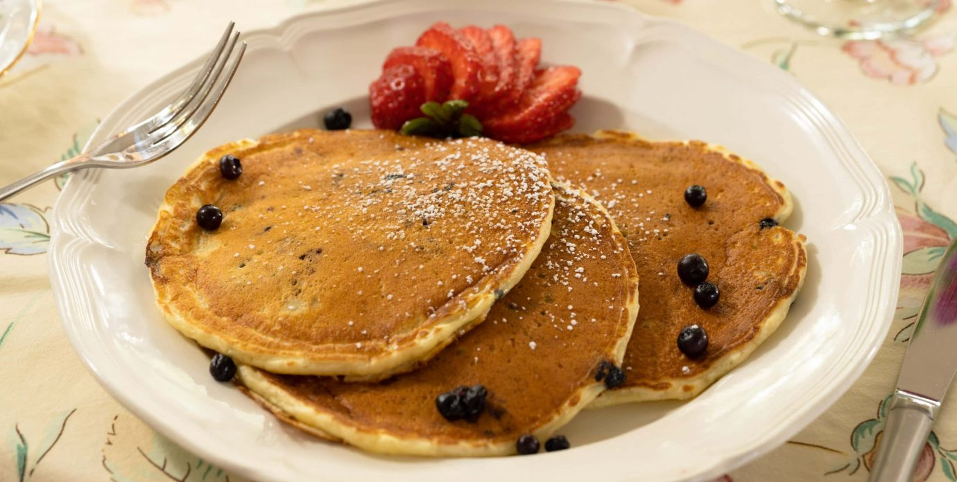 Blueberry Pancakes served with fresh strawberries