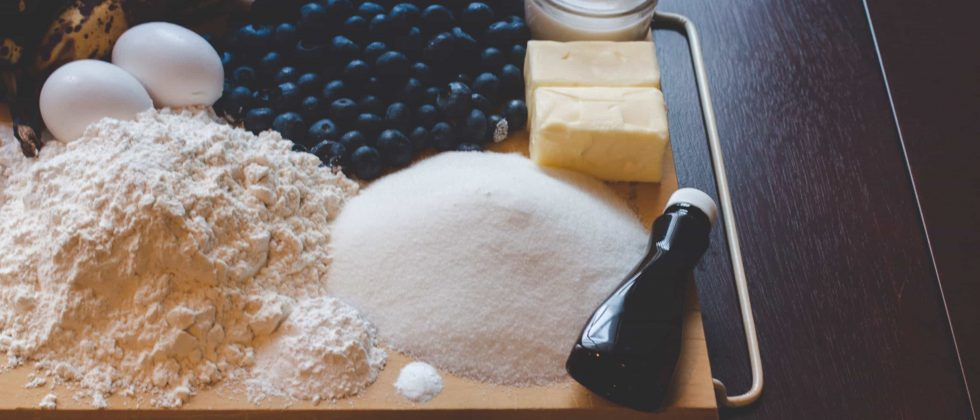 Baking ingredients and blueberries on a tray