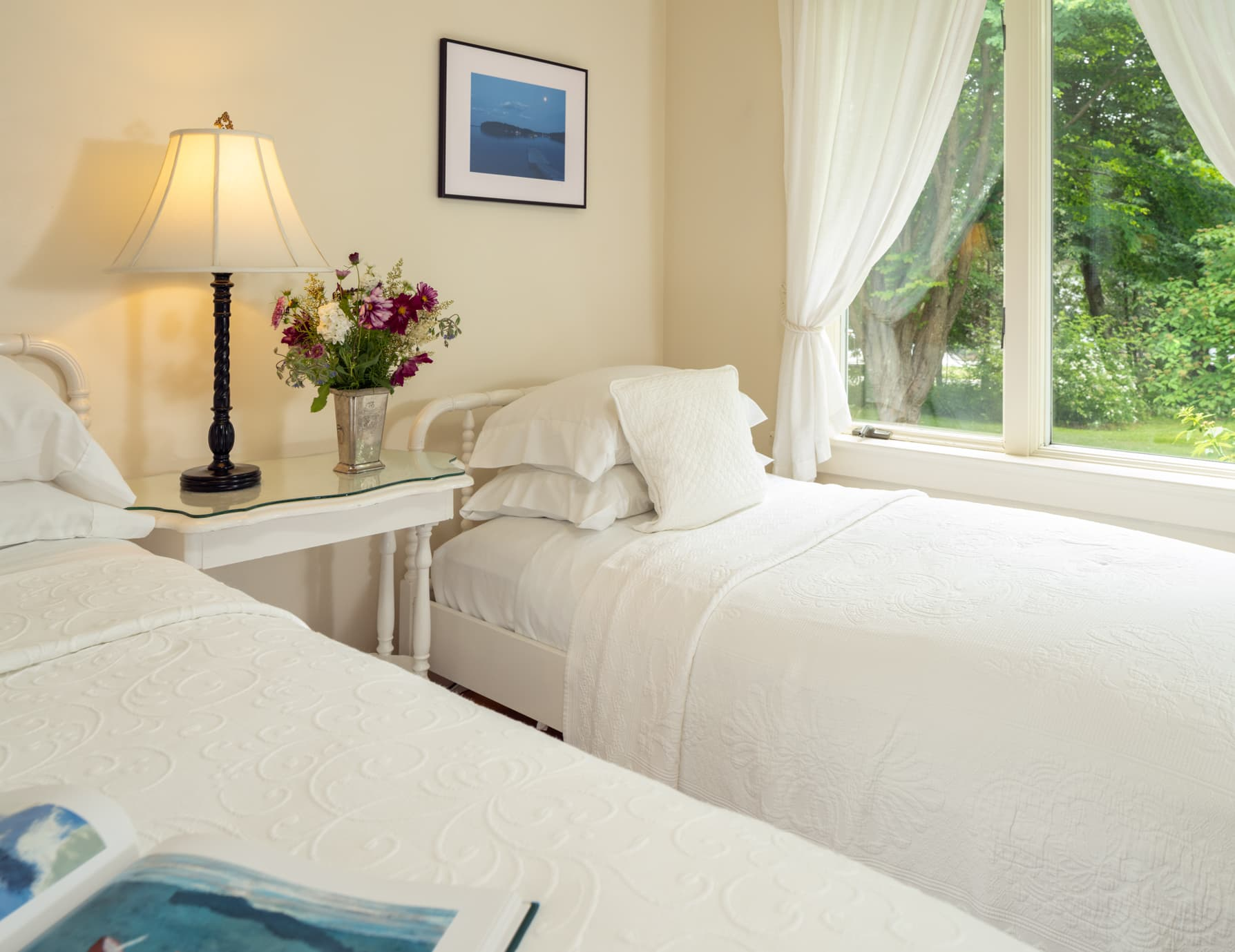 Cape House Studio twin bed next to the window