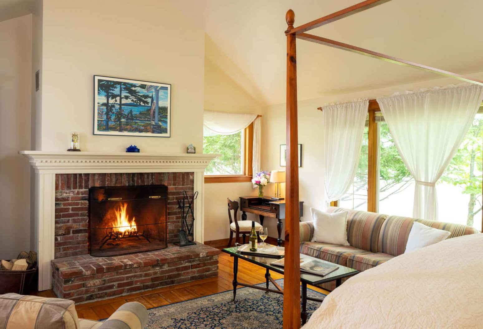Cape House Suite with a King bed a seating area and a large fireplace