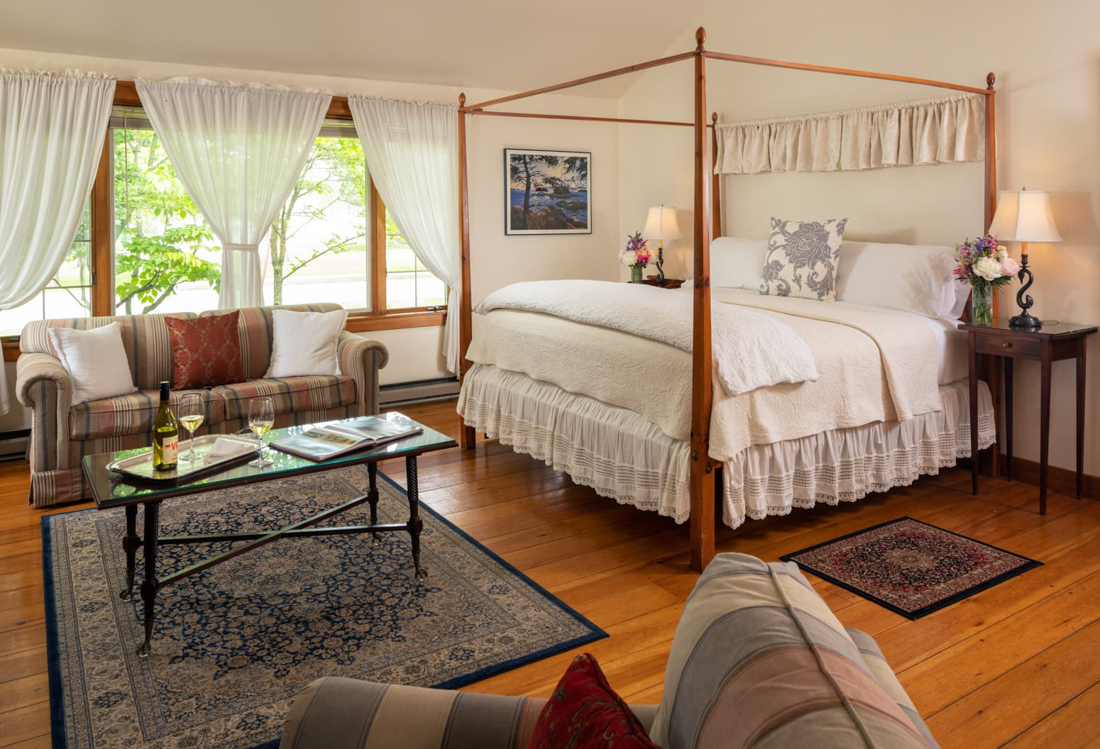 King bed in the Cape House Suite with a large seating area