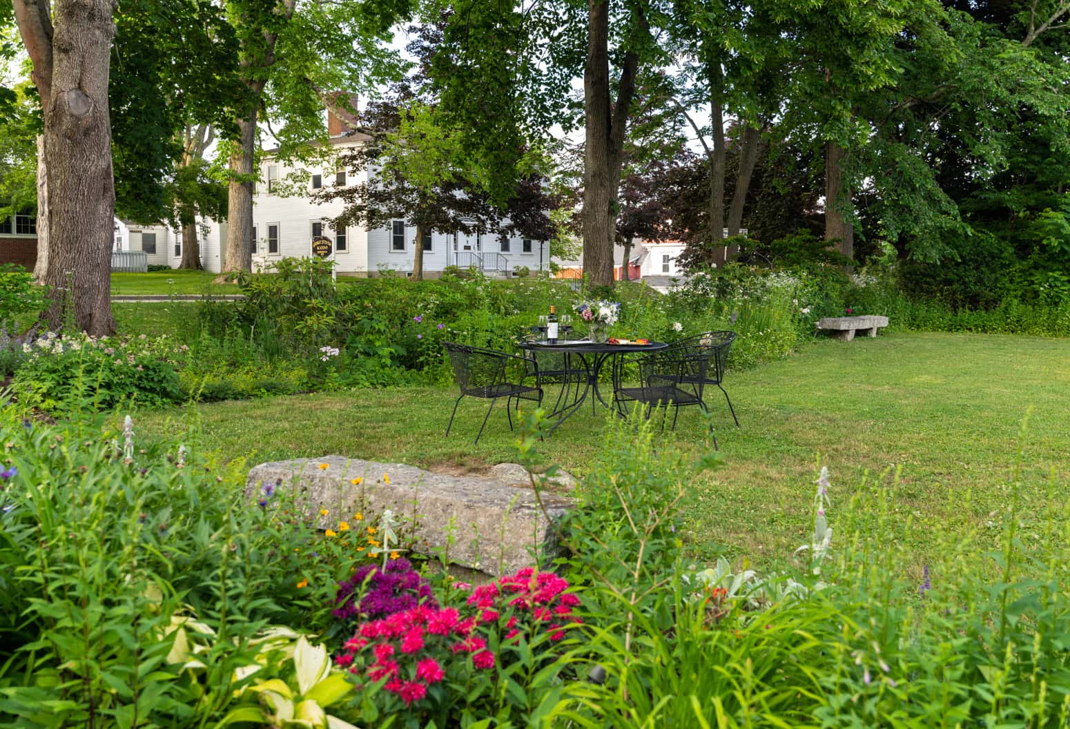Open spaced garden with flowers and herbs at Blue Hill Inn