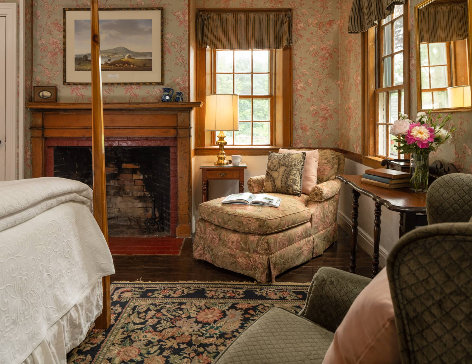 Room 11 with a king bed and a fireplace with a seating area for two