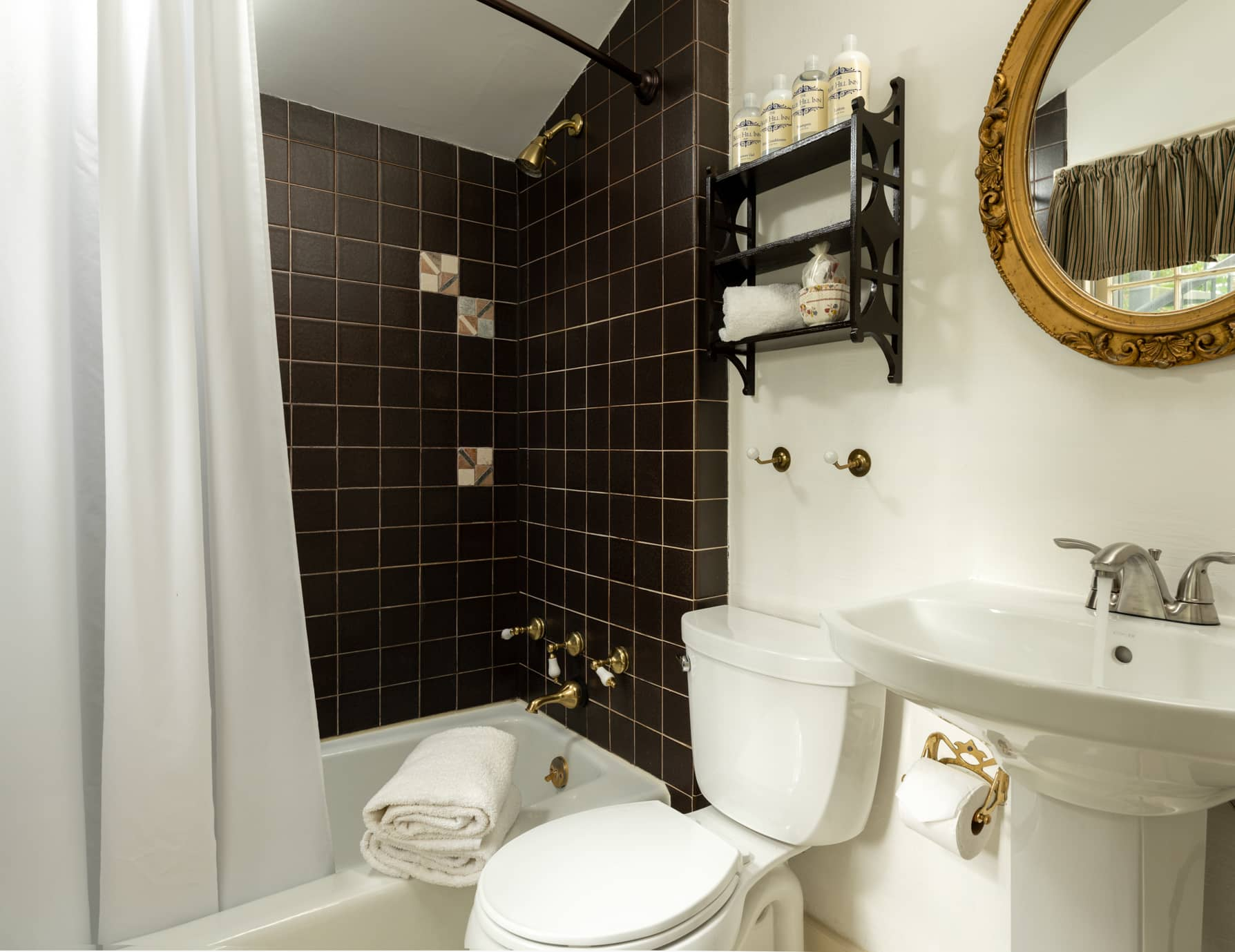 Room 11 bathroom with a sink and mirror and a tub/shower combination