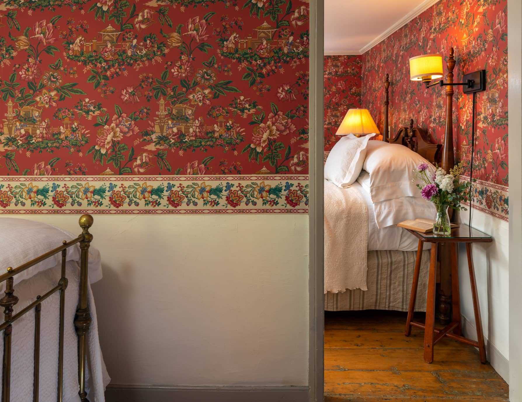 Room 2 with two beds in separate rooms and red floral wallpaper