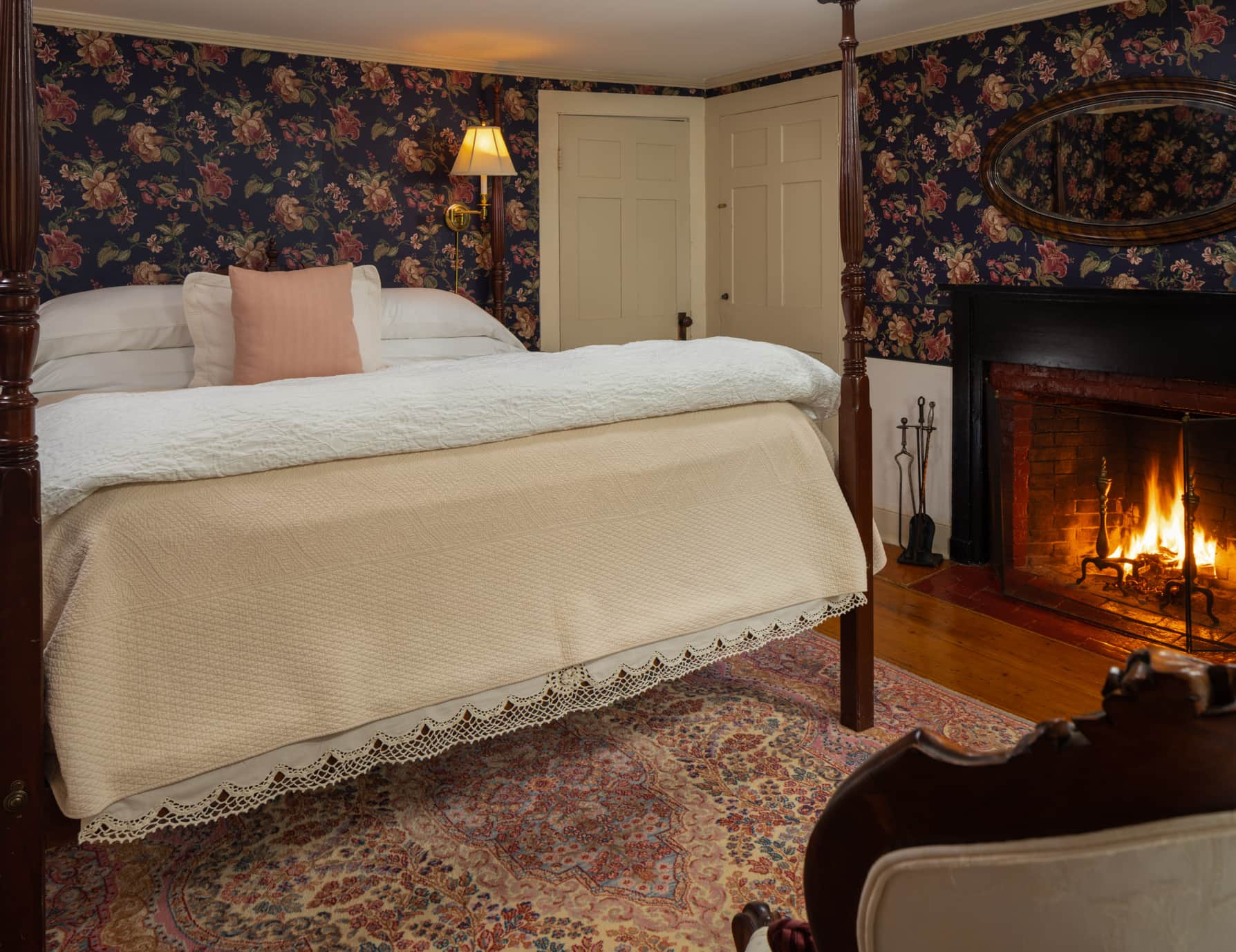 Room 4 with a King-size bed and fireplace with hardwood floors