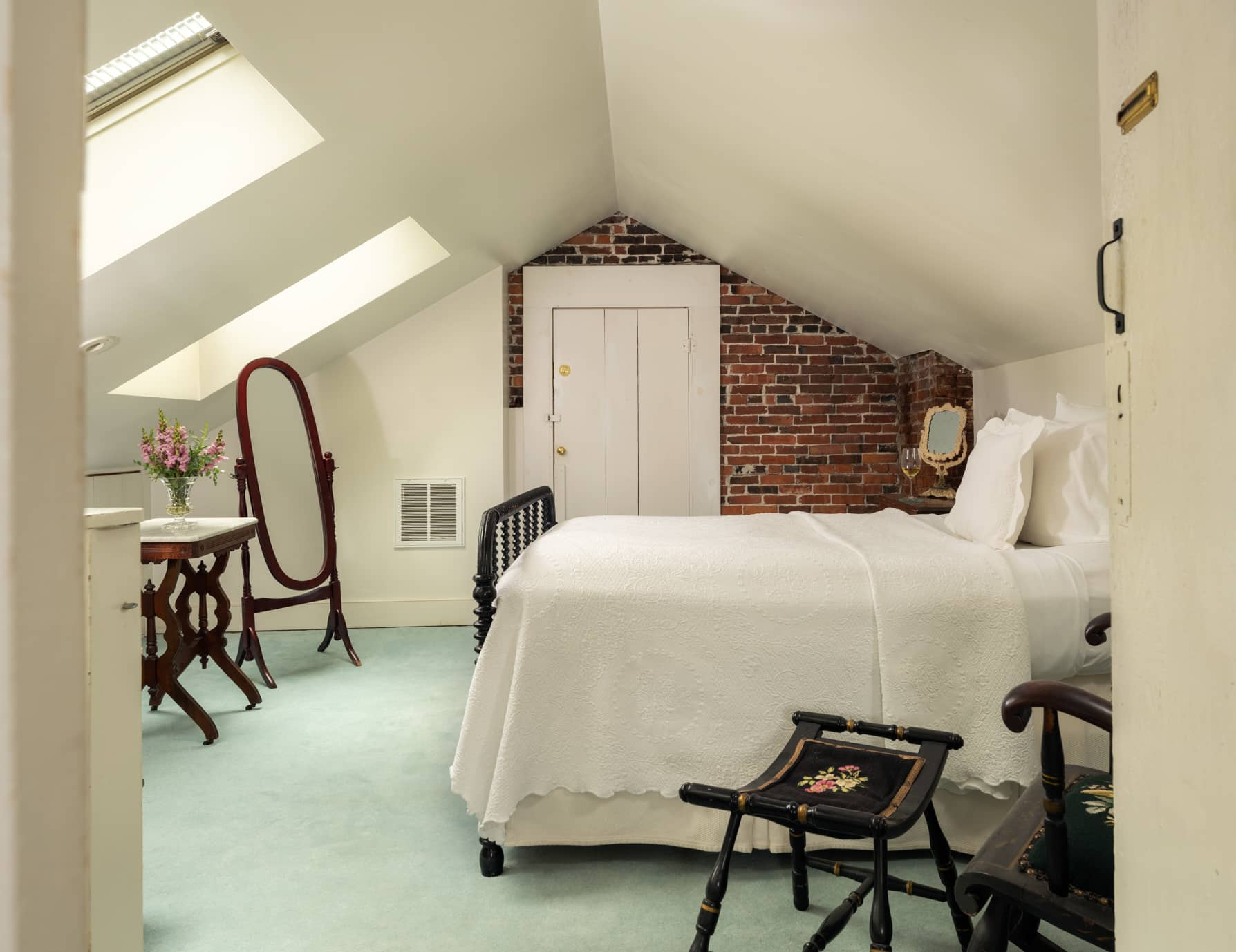 Room 9 three quarter bed in a third floor room with skylights