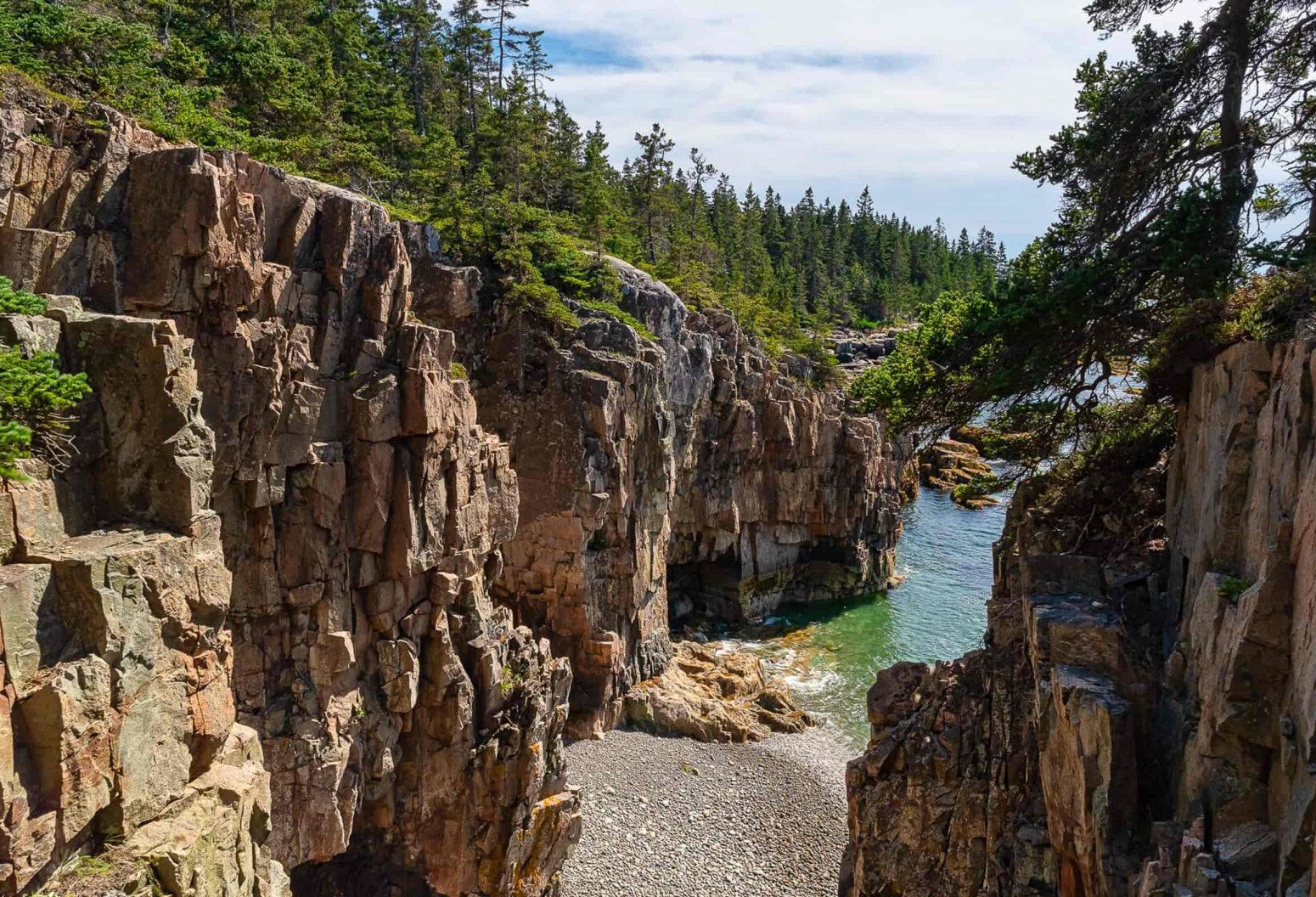 Maine rocky coastline with high cliffs and the ocean